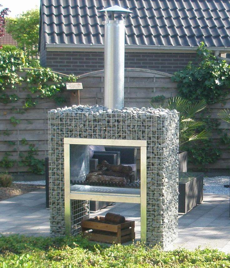 Met een houtas van een bbq de tuin bemesten - Deco van de tuin ...